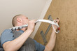 Air conditioning technician installs a new air conditioner