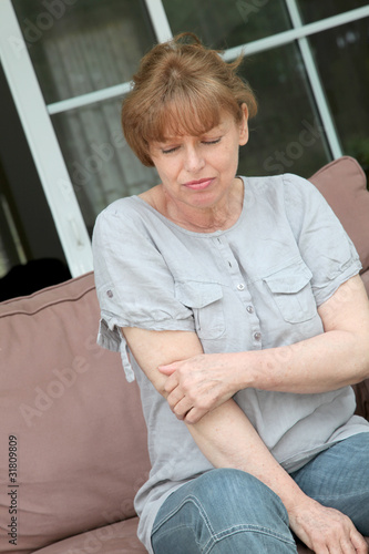 Senior woman with osteoarthritis pain
