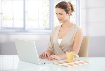 Young businesswoman working in bright office