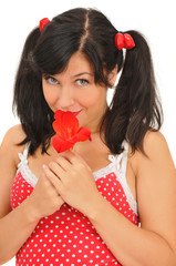 beauty girl with red flower looking at camera