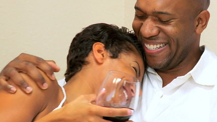 Happy Ethnic Couple Drinking Wine in Close-up