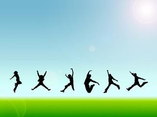 草原でジャンプする若者