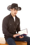 Cowboy with book looking