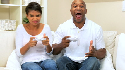 Ethnic Couple Playing on Games Console