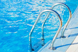 Ladder in pool with a handrail poster