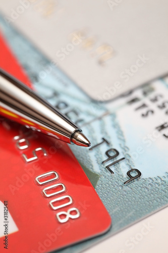 Close up view on credit cards and ballpoint