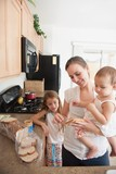 A Mother Making A Sandwich For His Girls