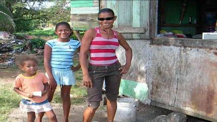 family posing native house Nicaragua