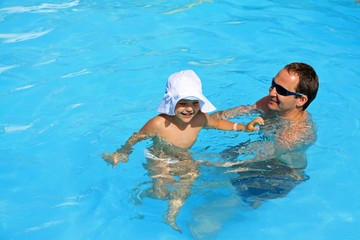 Playing a father and daughter at the pool