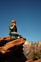 Teenage Boy Talking on Cell Phone In Zion