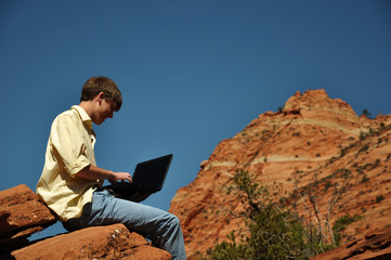 Teenage boy with laptop in zion