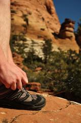 Tying Hiking Shoe in Zion National Park