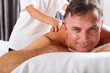 mature man having massage at spa