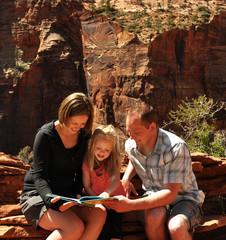 Family Reading in Zion National Park Utah