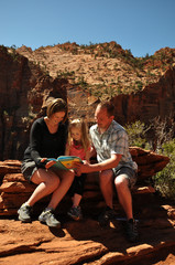 Family Reading a Book in Zion National Park