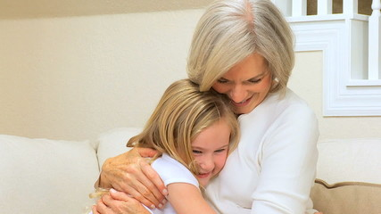 Cute Little Girl Being Hugged by Grandma