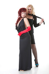 blond woman strangles red-haired rival