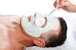 middle age man with facial mask in beauty salon