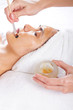 woman having honey facial in beauty salon