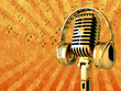 Golden Microphone with headphones on an orange background