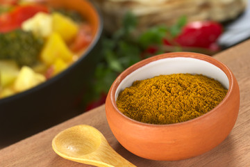 Curry spice in small bowl