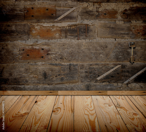 Old grunge room with vintage key on wooden wall