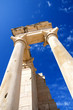 Columns of The Sanctuary of Apollo Hylates opposite blue sky