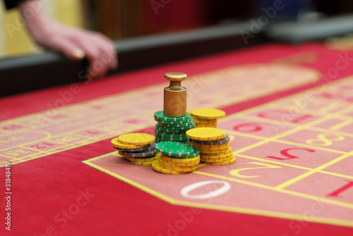 stack of chips on red roulette table