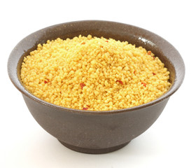 Brown bowl with couscous on white background