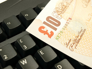 10 pound note on a keyboard (with UK layout)