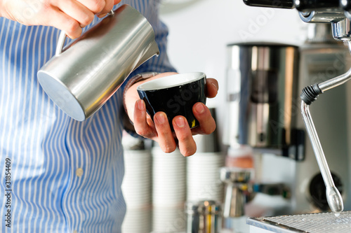 Barista prepares cappuccino