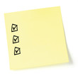 Yellow sticker checklist, blak tick marks and checkboxes, isola