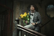 Young fashionable man holding bunch of flowers