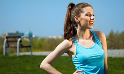 Smiling fitness woman.Park  background
