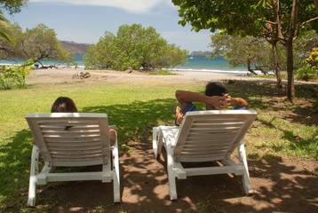 Two people taking a break in Coco Beach, Costa Rica