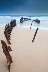 wreck on australian beach at dawn