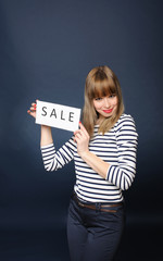 Pretty girl holding sale sign