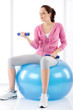 Fitness woman exercise dumbbell ball gym