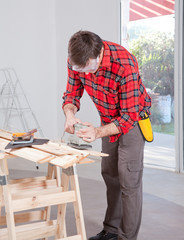 Man Using Electric Hand Sander