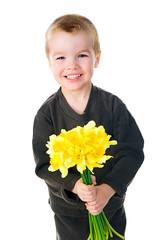 Cute little boy giving flowers