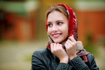 Young beautiful woman in a red scarf