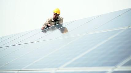 Technician working on solar panels; Full HD Photo JPEG