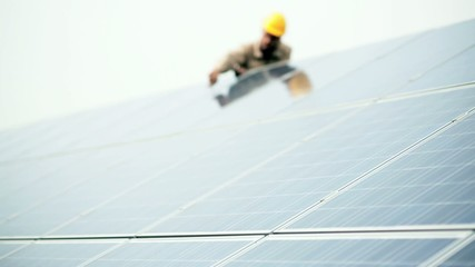 Technician working on solar panels; Full HD Photo JPEG