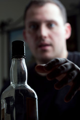 Man Reaching For the Liquor Bottle
