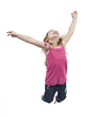 Adorable little girl jumping in air. isolated