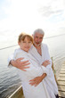Senior couple in bathrobe standing on a pontoon