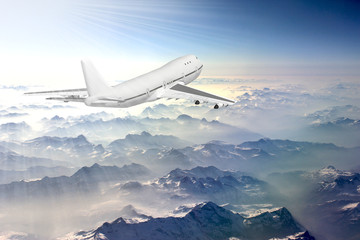Boeing 747 flying above the clouds in the sky