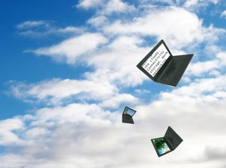 Cloud computing: laptop computers floating in the clouds