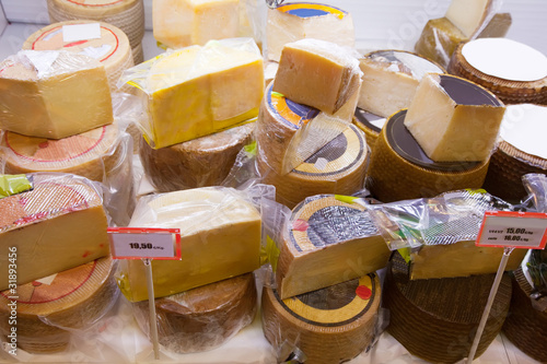 cheese on counter in  market