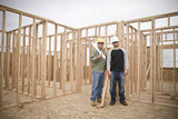 Building Contractors standing in an unfinished home poster